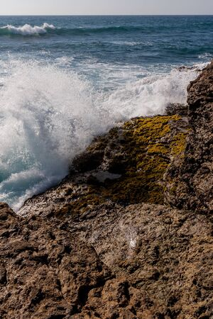 Waves crashing against the rocky coast of La Chocolatera near Salinas, Ecuador