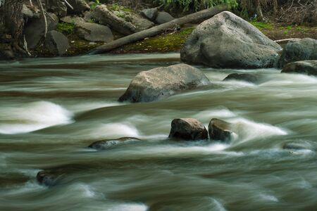 flowing water: Flowing Water of the R�o Yanuncay, Cuenca, Ecuador Stock Photo