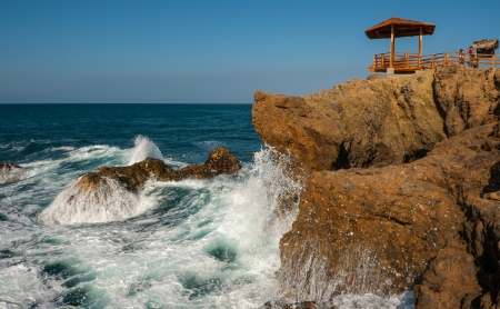 Waves splashing beneath the mirador at La Chocolatera near Salinas, Ecuador photo