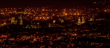 A night photograph of part of the city of Cuenca Ecuador.  Five churches are lit.  From left to right they are:  Catedral Nueva La Catedral de La Inmaculada Concepcin San Blas Santo Cenculo Santo Domingo and San Sebastin.
