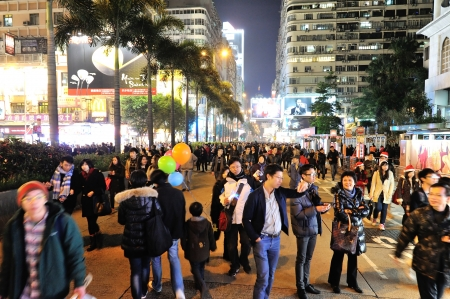 HONG KONG, CHINA - DEC 24, 2012: Christmas Eve in Hong Kong, pedestrian walk on the road instead of vehicles and wait for Christmas come.