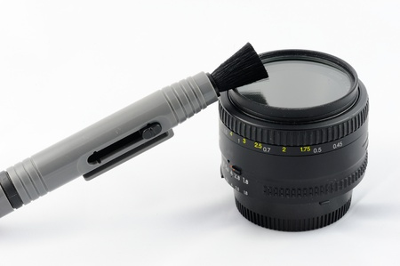 neccessary: Isolated lens cleaning kit on a white background Stock Photo