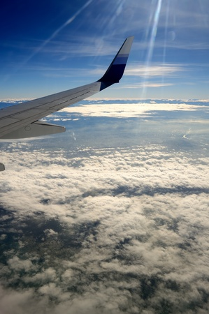 View from airplane with wing over Taiwan photo
