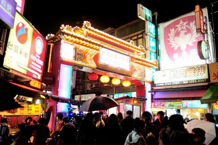 TAIPEI, TAIWAN - JAN 06, 2013: Night market on Jan 06, 2013 in Taipei, Taiwan. Night market is everywhere in Taiwan, most of them sell special local food.