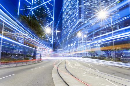 Car trail during Hong Kong dark night with high building Standard-Bild