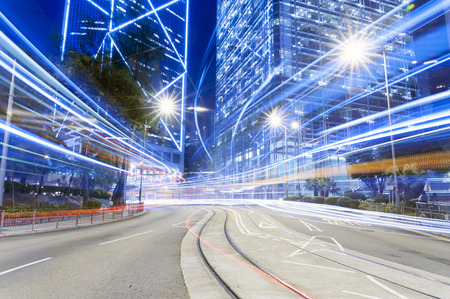 night skyline: Car trail during Hong Kong dark night with high building Stock Photo