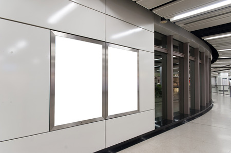 white poster: Empty White Billboard inside building