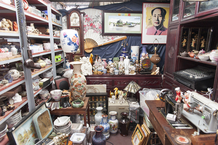 fleamarket: Hong Kong, China - 24 OCT 2015: A Chinese flea market shop which is selling a lot of different products, mostly second hand