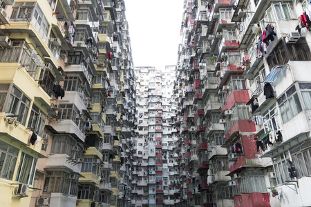 overpopulated: Very Crowded but colorful building group in Hong Kong