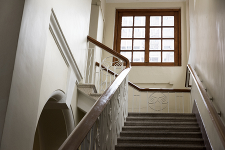 stair well: Stair inside a old building, leading to a window Stock Photo