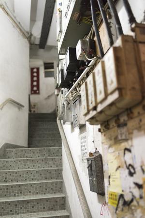 tenement buildings: HONG KONG, CHINA - 24 FEB 2016: Stair of Tong Lau, tenement buildings built in late 19th century to the 1960s in Hong Kong. Editorial
