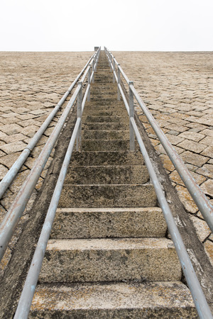 stair: Endless stair on a Dam Stock Photo