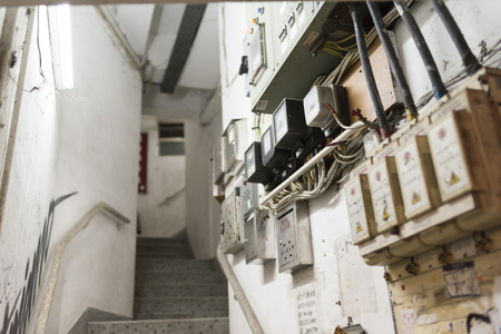 old building: HONG KONG, CHINA - 24 FEB 2016: Stair of Tong Lau, tenement buildings built in late 19th century to the 1960s in Hong Kong. Editorial