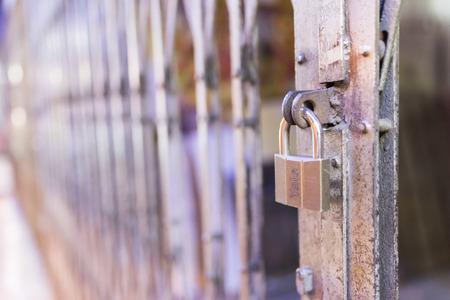 padlocked: Closed Metal gate at night