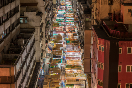 fleamarket: HONG KONG , CHINA - 15 MAR 2016: Temple street at night on March 15, 2016 in Hong Kong, China. Temple Street is the most famous night market. Late night shopping is quite typical for Hong Kong culture.