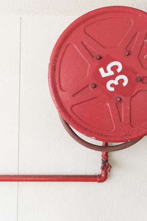 fire plug: Red fire hoese on the wall