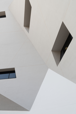 futuristic city: Abstract white building exterior with some windows Stock Photo