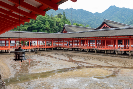Miyajima, Japan - June 27 2017: Itsukushima Shrine, Japan. Itsukushima Shrine is a Shinto shrine on the island of Itsukushima (popularly known as Miyajima), best known for its floating torii gate. Editorial