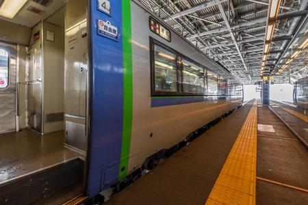 Asahikawa, Japan - Feb 15, 2019: A blue train Super Express, between Abashiri and Asahikawa.