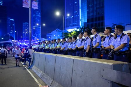 HONG KONG - June 9, 2019: Hong Kong June 9 protest. Police confronting the people.