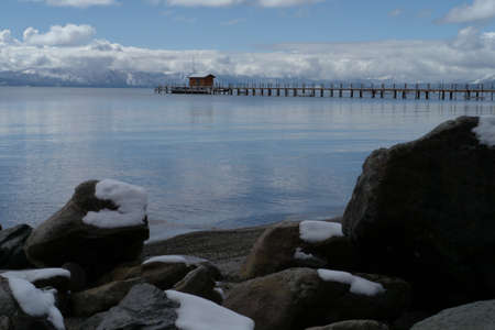 Lake Tahoe boat dock with snow on rocks photo