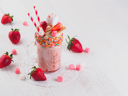 Pink strawberry freakshake with sweets