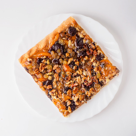 Cake with raisins, prunes and dried apricots. Isolated.