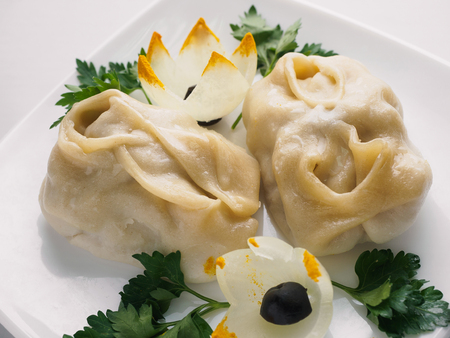 Beef manta dumplings with meat on the plate.