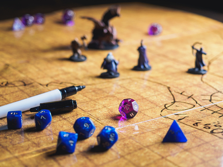 Roleplay game with dragons in dungeon. Yellow field dice. Banco de Imagens