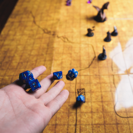 Roleplay game with dragons in dungeon. Yellow field dice. Stock Photo
