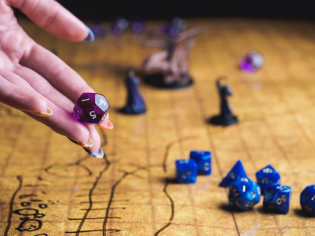 Roleplay game with dragons in dungeon. Yellow field dice. 版權商用圖片