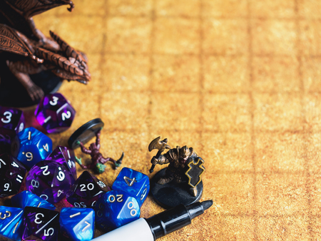 Roleplay game with dragons in dungeon. Yellow field dice. Archivio Fotografico