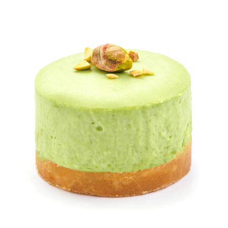 Green chocolate round cheesecake. white isolated background.