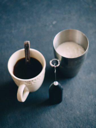 Cappuccino coffee mixer milk frother with metal cup.