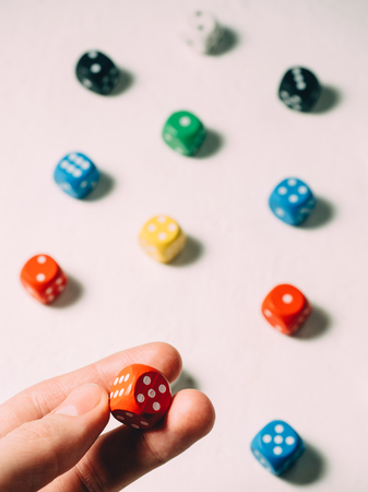 Color dices in hand. Board game casino risk luck. Stock Photo