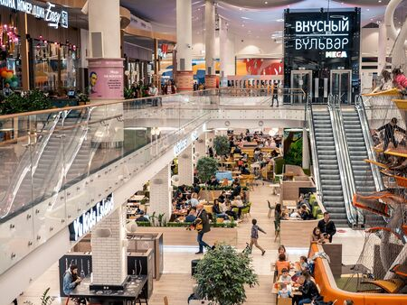 KAZAN, RUSSIA - MAY 5, 2019. MEGA mall shopping center. People in the Delicious Boulevard - food court.