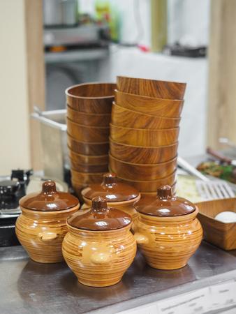Crockery clay pots bowls in cafeteria display.