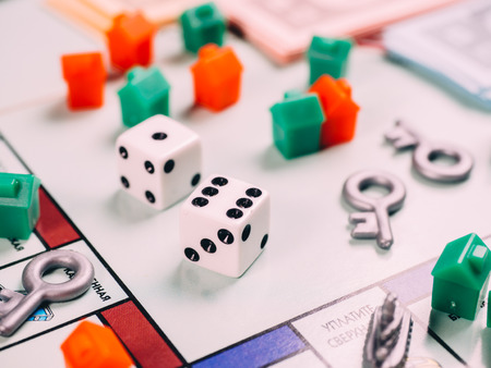 Classic business monopoly board game with dices and field.