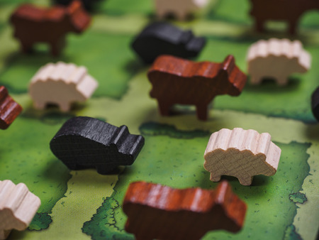 Farm agricola board game with fields figures and animals.