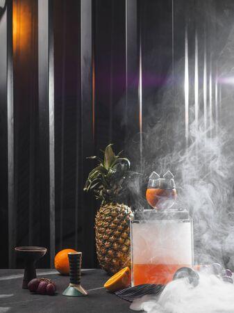 Modern smoky hookah with orange and pineapple. 版權商用圖片