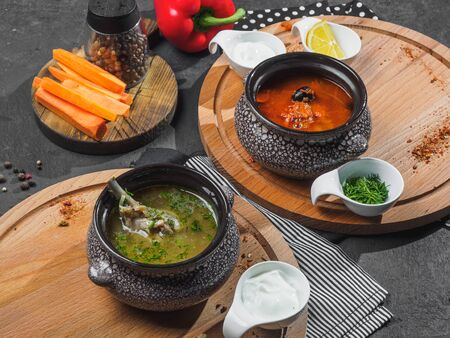 Two soups on boards: solyanka and chicken soup.