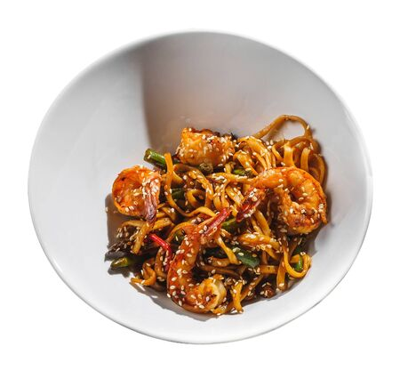 Wok shrimps prawns with noodles and vegetables. Isolated