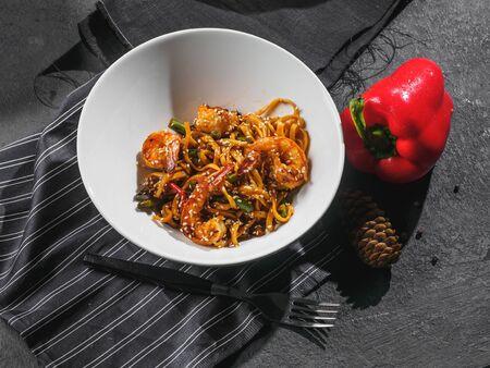 Wok shrimps prawns with noodles and vegetables.