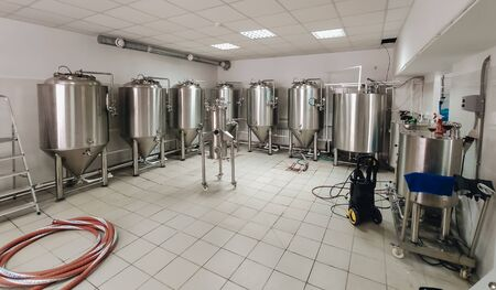 Brewery alcohol factory production. Modern containers technology.