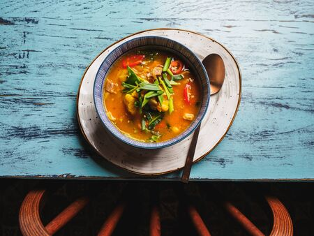 Mexican soup with corn chili pepper and meat.