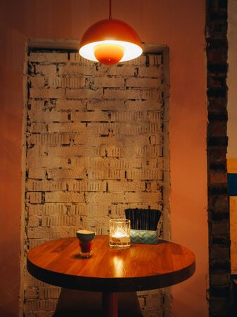 Interior of mexican cantina bar with dim lights and candles.