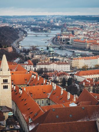 Red roofs of old medieval town in Prague. Winter Standard-Bild