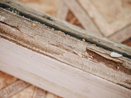 Old dirt rotten wooden retro white window. Фото со стока