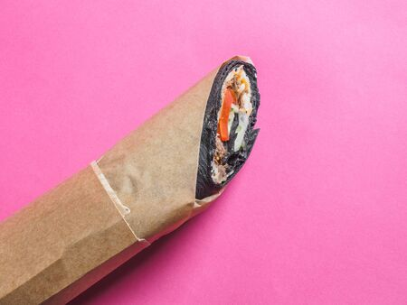 Shawarma roll with black pita on pink