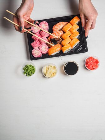 Set of sushi rolls in delivery plastic boxes on white background. Stok Fotoğraf